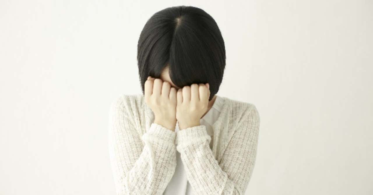 _photo_AC_顔を覆う女性